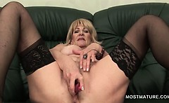 Blonde erotic mature lady nailing herself with sex toys