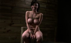 Tied against a post busty Asian babe gets fucked