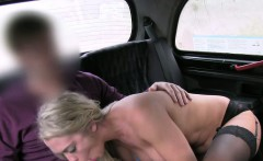 Blonde babe in stockings fucking in fake taxi