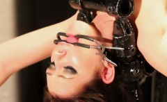Gagged sub bent backwards and fingered