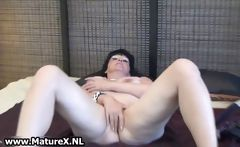 Mature lady spreads her shaved pussy