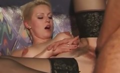 Short haired blonde MILF in stockings